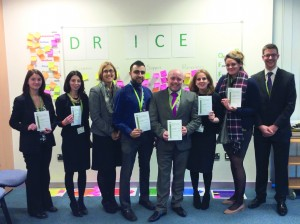Above: Six new members of the OLEVI family proudly holding their certificates, with Jackie (third from left) and Ashley (far right)