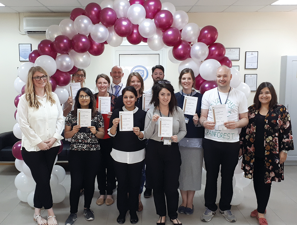Teachers at the Qatar International School celebrate completing the Outstanding Teacher Programme